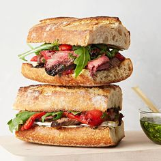 Dinner stakes are high when it's #NationalSandwichDay, but this cheesy steak-filled number with chimichurri sauce is here to save the day. Find the recipe in our bio link. (: @armandorafaelphotography)