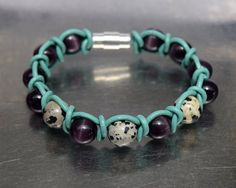Items similar to Purple cats eye and dalmatian jasper beads (semi precios stones) turquoise leather cord - wrap bracelet on Etsy Purple Cat, Dalmatian, Leather Cord, Cat Eye, Jasper, Stones, Turquoise, Beads, Trending Outfits