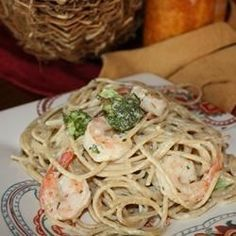Angel hair pasta is tossed with sauteed shrimp and steamed broccoli, and topped with a rich garlicky cream sauce.