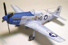 P-51 Mustang by John Dell.  You can find printable downloads for paper models at Fiddler's Green.
