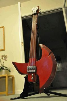 Marshall lee's guitar (well its more of a bass version of his guitar but pre cool) Marshall Lee plays the guitar while Marceline plays the bass guitar look it up