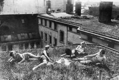 Girls enjoying the grass on a roof in Berlin, 1926