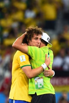 Germany 7- Brazil 1: a tearful David Luiz is consoled by Thiago Silva after the disastrous result.
