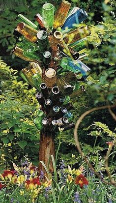 "A Bottle Tree For My Garden ""Reuse of Junk"""