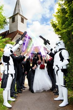 Star Wars wedding This looks similiar to a wedding we went to this year. The groom came in dressed like Darth Vader and his doom/gloom music was playing.