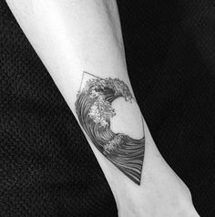 Diamond framed wave tattoo. The wave is enclosed in a diamond shaped frame as it builds up to form an arch over the ocean before crashing down.