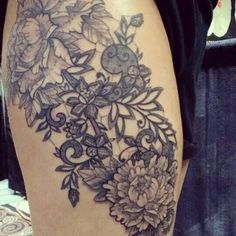 Lace and peonies on outer thigh