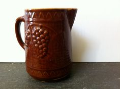 "Vintage Pitcher in Brown with a high glaze  and Yellow ware interior Star on bottom.  7"" Tall  by AntiqueCarla@etsy.com"