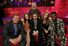 Host Graham Norton (centre top) with (left to right) Arnold Schwarzenegger, Emilia Clarke, Jake Gyllenhaal, Delevingne, and Tinie Tempah during filming of the Graham Norton Show at the London Studios, south London, to be aired on Friday.