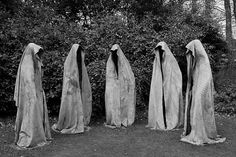 Hooded figures. Put lights near them and there will be an instant creepy factor. :)