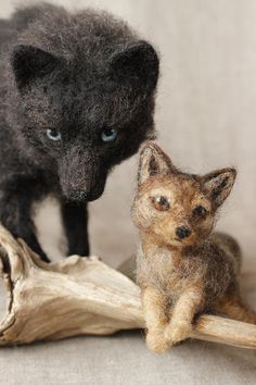 Needle felted wolf and pup by Hannah Stiles