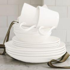<li>Set includes: Four (4) dinner plates, four (4) salad plates, four (4) all-purpose bowls, four (4) mugs</li> <li>Material: Stoneware</li> <li>Color: White</li>