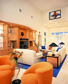 Blue and orange living room. That's a FLorida Gator room. Omg if I had a bigger house!!!!