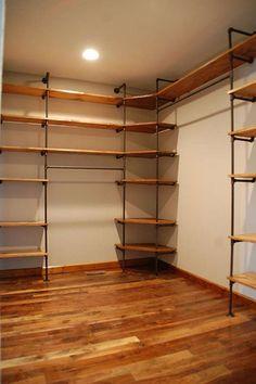 Easy DIY closet shelves, perfect for a master closet. Diy Pipe Shelves, Wood Shelves, Pipe Shelving, Industrial Shelving, Corner Shelves, Floating Shelves, Vintage Industrial, Pantry Shelving, Industrial Lamps