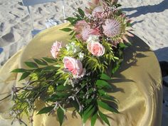 Proteas and roses made a stunning bridal bouquet for Natalie's and Kahl's Inskip Point wedding near Rainbow Beach.