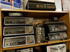 Pile of old school analog scanners.   Radio Shack and Bearcat. VHF / UHF some programmable, some crystal scanners