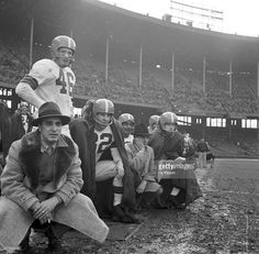 Cleveland Browns coach Paul Brown (second from right) with QB George Ratterman (far right) on sidelines during game vs Detroit Lions at Cleveland Municipal Stadium. Cleveland, OH