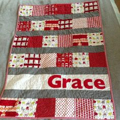 "Fun, easy cute baby quilt.  Just picture. no tutorial..... It looks like 7""squares six across then 4"" strip then a 7"" strip then a 4"" strip... Then alternate a rows of 7"" squares then 4"" strips.  Appliqued name."