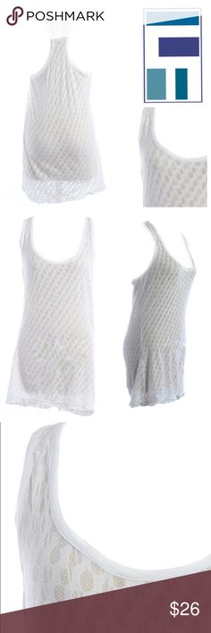 "NWT LF White Textured Racerback Tank NWT LF White Textured Racerback Tank  Geared towards girls who dare to be different, LF has become the must have destination for many fashionistas who crave upcoming trends on the fashion circuit.    -Emma & Sam for LF -Brand new w/tags -Size small -Measurements laying flat (Bust:34"", Waist:34"", Length:28"").  -Made in the USA -Machine Wash Cold. Material: Self: 100% cotton Contrast: 100% rayon  *free gift w/every purchase!   Check out my seller discount…"