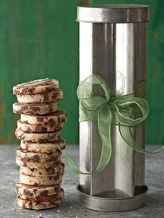 Vintage Cookie Tin ~~ Cutout cookies with peppermint flavors are super simple to make in bulk. Place them inside a vintage cookie tin (hunt online for the best options) and tie with a sheer ribbon to gift in style.
