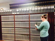 The Office of the Essex County Clerk will make their records available online starting on Jan. including the daunting rows of shelves Principal Records Management Clerk Chelsea M. Merrihew can be seen examining above. Records Management, Essex County, The Office, Chelsea, Community, Box, Design, Snare Drum, Boxes