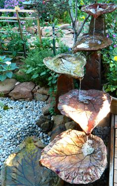 Tiered Leaves. I want something like this for water drainage away from the house!