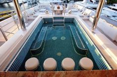 Jacuzzi on top deck WITH bar stools....too much! Dream boat (literally)