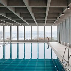 Illiz Architektur built this indoor swimming pool on top of a disused concrete shelter for rescue forces, offering bathers views of Lake Zurich.
