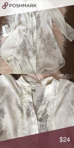 White blouse Adorable American rag blouse. One string broke off to tie around the waist but can be accessorized with a belt. Size xs. American Rag Tops Blouses