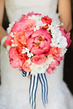Peach and coral with white wedding bouquet with blue striped ribbon