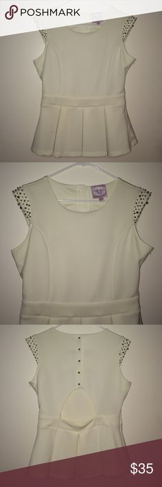 White peplum top White peplum top cut out back silver beads on the shoulder and silver buttons down the back zip side Romeo & Juliet Couture Tops