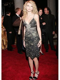 For her first time at the BMI Country Awards, Taylor went for red-carpet glam in this jewel-encrusted black cocktail dress. This night not only marked her singing debut, but the start of her signature sparkly style.