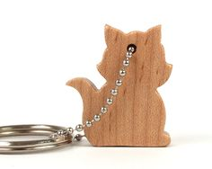 This simple outline cat or kitten key chain was cut from maple on a scroll saw. I attached a 4 inch long ball chain and a 32 mm split ring to securely hold your keys. The cat is 1 1/2 tall by 1 3/8 wide and 3/8 thick. You can find more simple silhouette key chains here: http://www.etsy.com/shop/OohLookItsARabbit?section_id=7226558 USA State key chains are here: https://www.etsy.com/shop/OohLookItsARabbit/search?search_query&#...