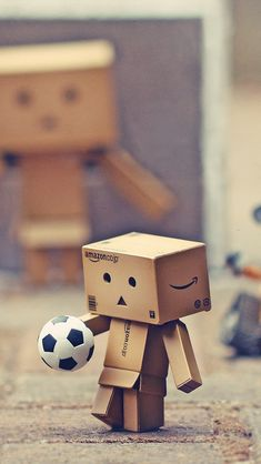 Danbo And Other Toys To Play Football iPhone Wallpapers Hd Wallpaper App, Love Wallpaper, Danbo, Football Wallpaper Iphone, Cardboard Robot, Cardboard Boxes, Amazon People, Box Robot, Robot Costumes