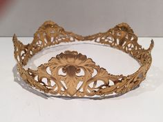 A personal favorite from my Etsy shop https://www.etsy.com/listing/245136141/gold-crown-crown-headdress-mid-evil-gold