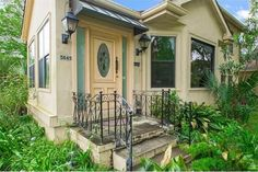 5845 Canal Blvd, New Orleans, LA 70124 lush landscaping at front entrance iron railing