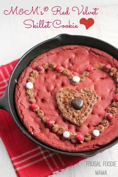 This M&M's Red Velvet Skillet Cookie is studded with M&M's Red Velvet candies and then topped with a decadent dark chocolate cream cheese frosting made using Dark Chocolate DOVE®️️ Promises.