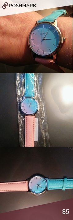 Lg Face Peachy Pink Aqua Silver Fashion Watch Pretty summer style peachy pink & aqua watch will go great with so many outfits! Cased in silver metal with silver time points. Measures 9 inches. Brand new in package. oktime Accessories Watches