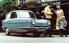A RELIANT ROBIN! AWESOME! Such a great photo!