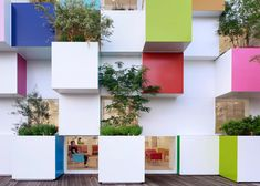 Trees sprout out of the rainbow-coloured cubes that make up the facade of this bank.