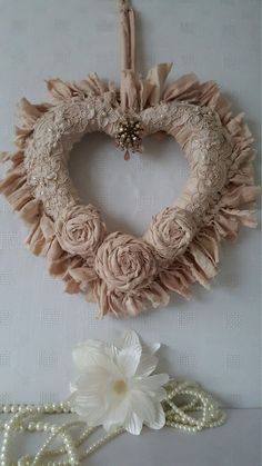 Check out this item in my Etsy shop https://www.etsy.com/uk/listing/262029368/vintage-style-cream-rag-wreath-shabby