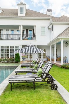 poolside black and white striped chaise lounges