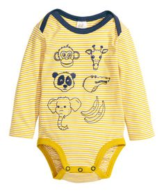 Long-sleeved bodysuit in soft jersey with a printed pattern, lapped shoulders, and snap fasteners at gusset.
