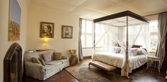 A bedroom at the Giraffe Manor. See more of the hotel where you get to eat breakfast with giraffes.