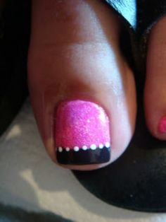 Pink and black gel toes