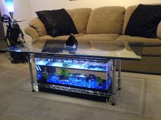 Aquarium Coffee Table by Steps + Collection I Made it! Favorite Build an aquarium coffee table for a fraction of the . Fish Tank Table, Fish Tank Coffee Table, Diy Coffee Table, Diy Table, Aquarium Design, Diy Aquarium, Aquarium Fish Tank, Acrylic Aquarium, Aquarium Stand