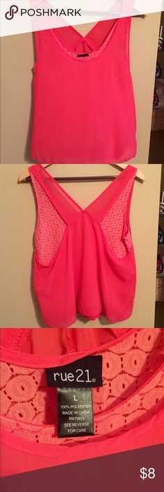 Hot pink top Rue 21 brand. Says size large, but it's not that big. Hot pink with a cute design under the first layer. Rue 21 Tops Tank Tops
