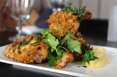 Chicken wing confit with parsley, breadcrumbs and dijones from GEM Restaurant and Lounge in Boston, MA.