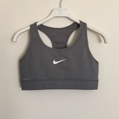 Nike dri-fit Heather grey sports bra small Great condition. Swoosh has a few small cracks in it. No tags but I'm pretty sure it's a small. Bundle to save 25%! Nike Intimates & Sleepwear Bras