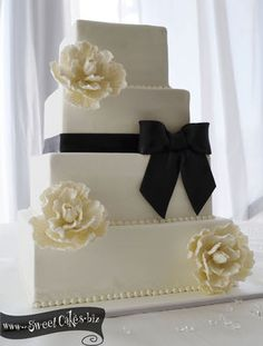 Classic Black and White Wedding Cake.  Wouldn't this be pretty with red roses instead of white?